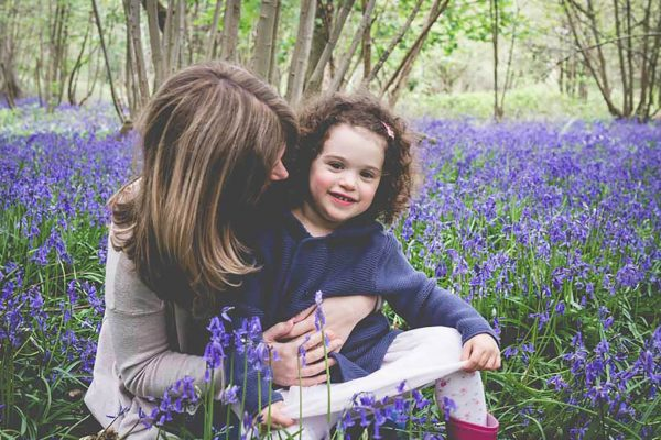 Mum and girl in the bluebell woods