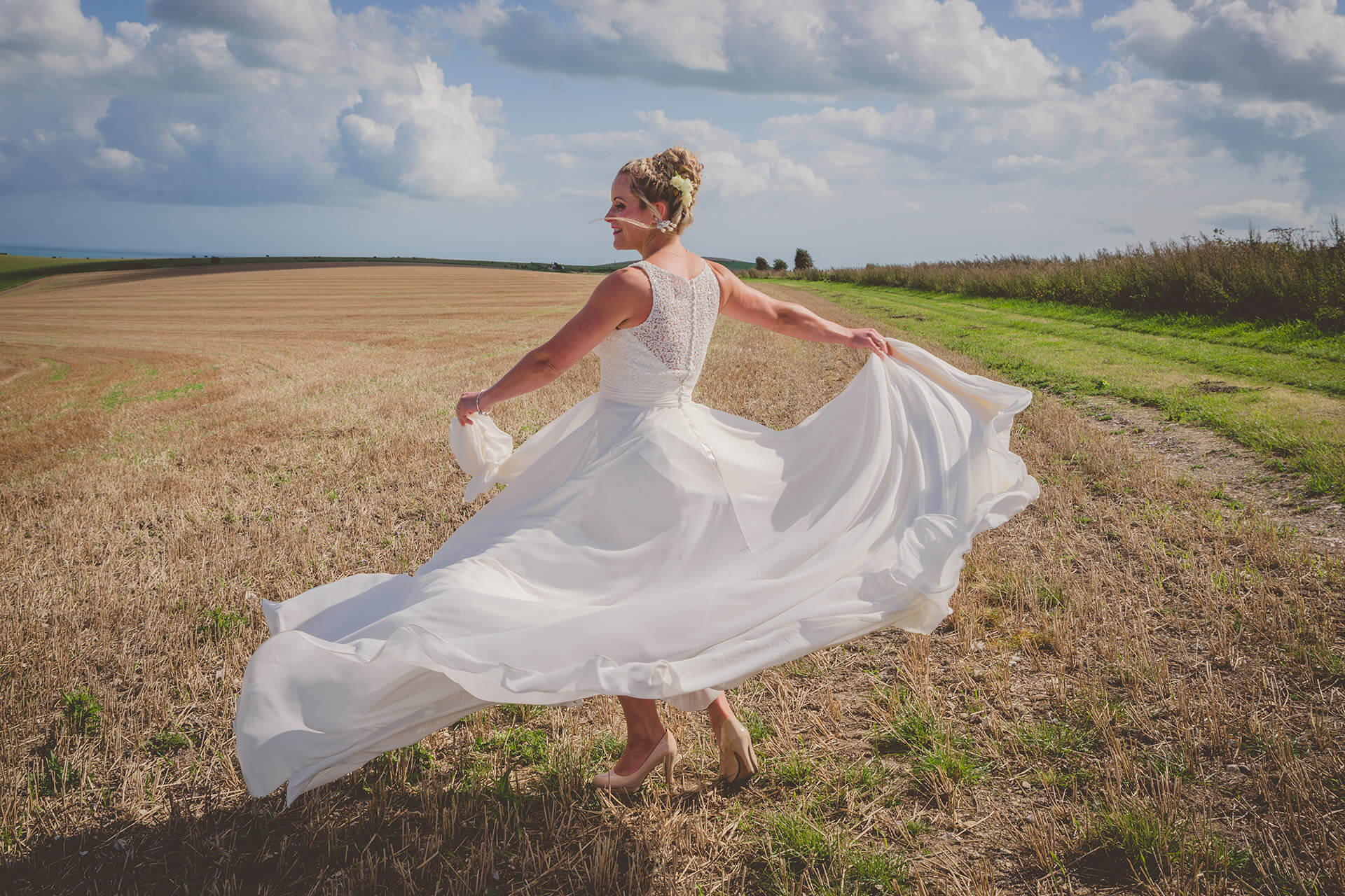 Bride twirling her dress