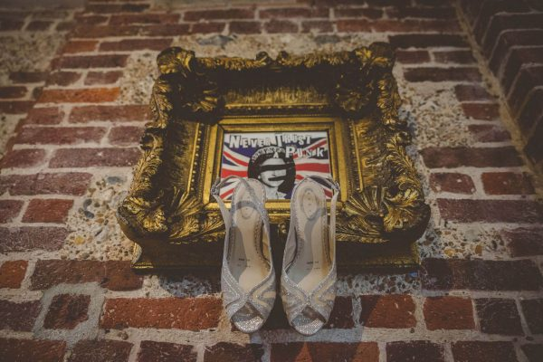 Bridal shoes hanging off a frame