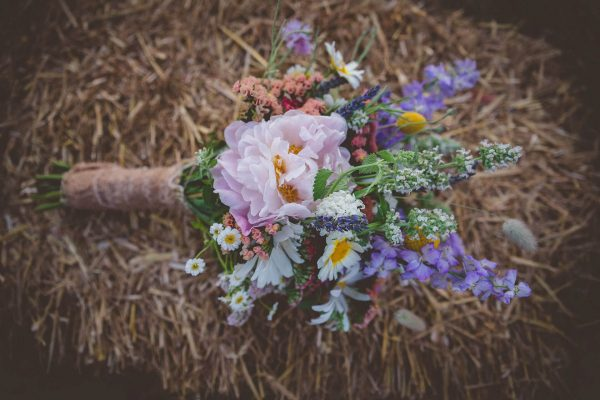 Bridal flowers on a hay stack