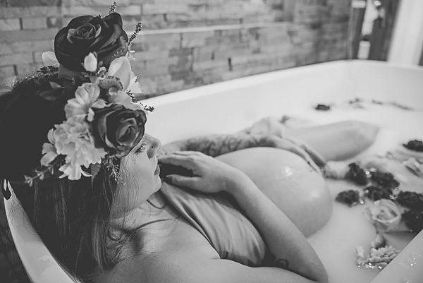 Pregnant woman in a bath of milk