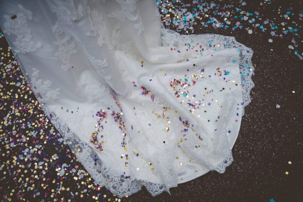 Wedding dress train covered in flower petals