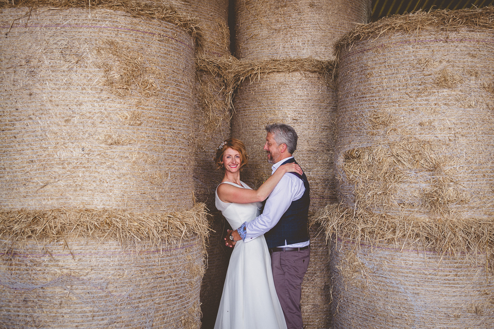 Bride and groom with hay bales