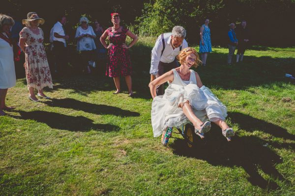 Bride in wheel barrel