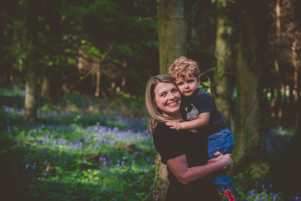 Mum and little boy in bluebell woods