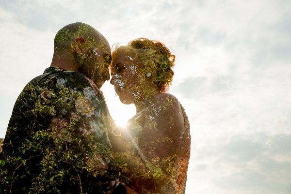 Bride and groom double exposure blended in with the trees