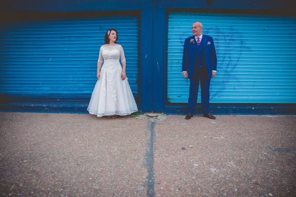 couple in front of a blue door