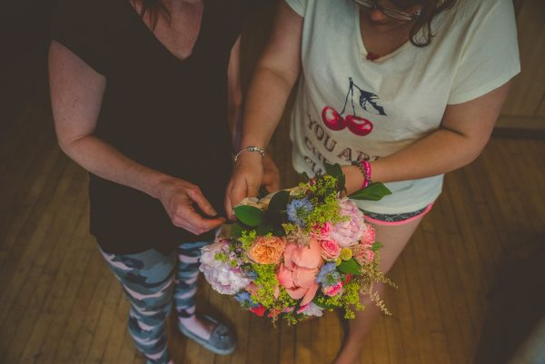 Bridesmaids fixing the flowers