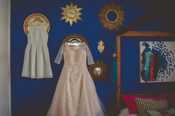 Bride and bridesmaids dresses hanging of the wall