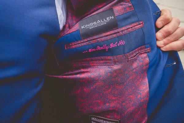 details of the inside of groom's jacket