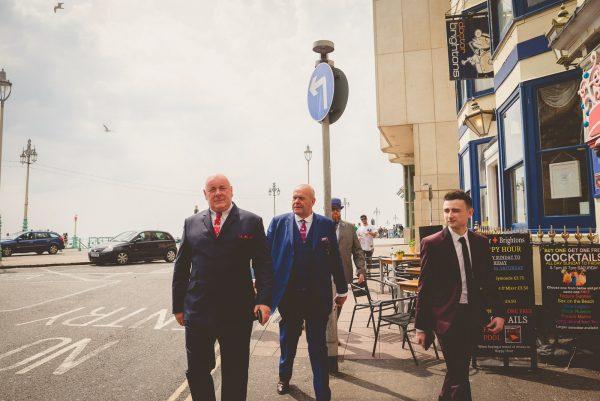 Groom and friends walking in Brighton