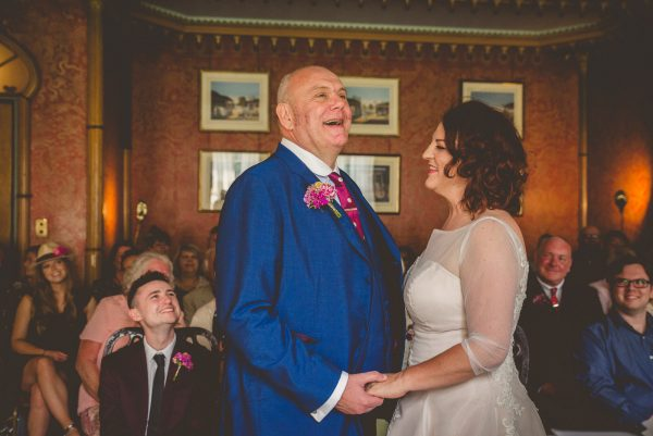 Groom lauhging at his brighton wedding