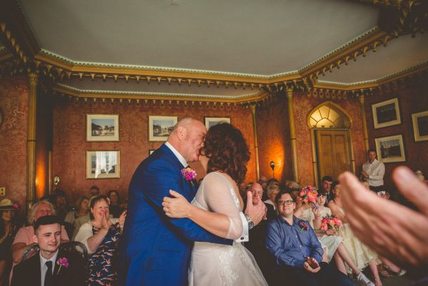 First kiss as a married couple in Brighton pavilion