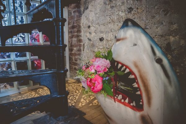 Shark head with bridal bouquet in his mouth