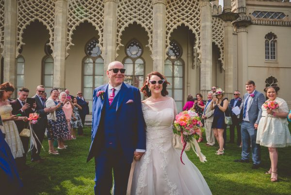 Bride and groom looking cool leaving the pavilion