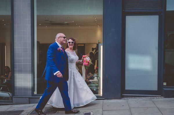 Bride and groom walking in Brighton