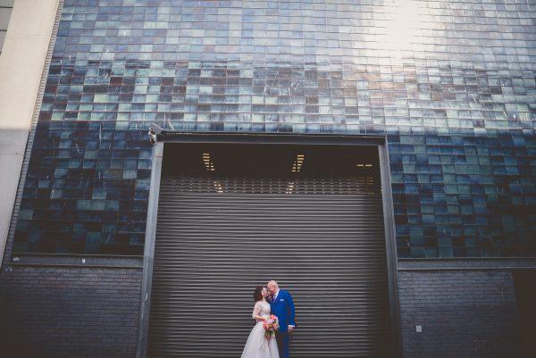 Bride and groom pose for photos around Brighton