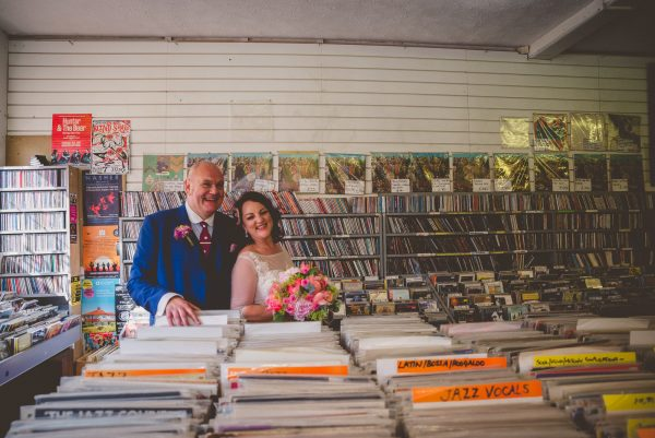 Bride and groom browse in record store
