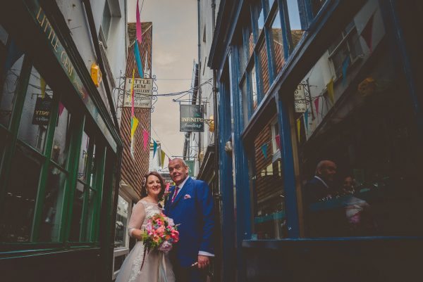 Bride and groom walking in the laines in Brighton