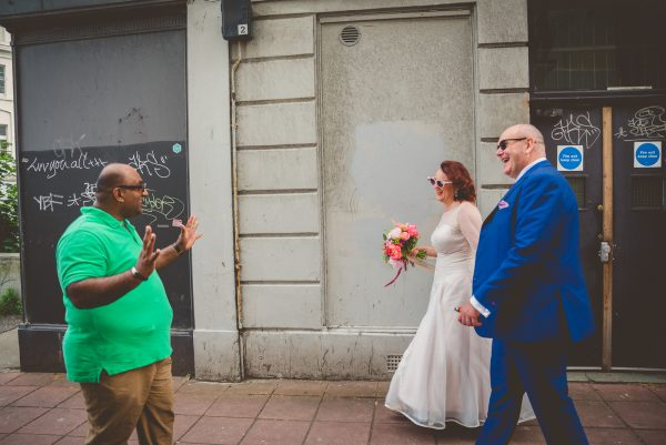 Bride and groom get greeted by brighton people