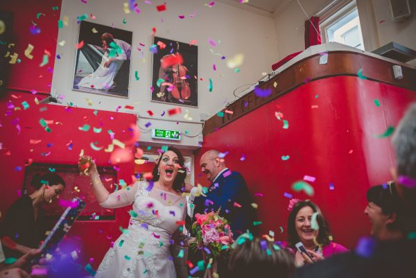 Bride and groom epic confetti entrance to the latest music bar in Brighton