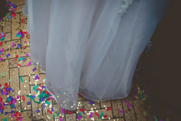 Detail of the confetti with the bottom of the bride's dress