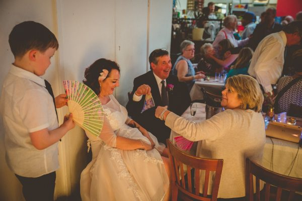 Guests giving bride air