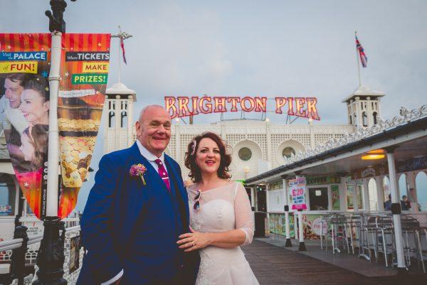 Couple outside Brighton pier for wedding photos