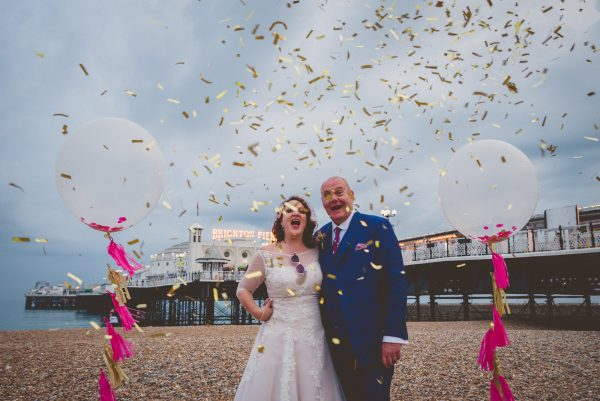 balloons and confetti at Brighton beach wedding